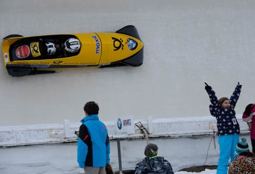 Yellow bobsled with kids cheering