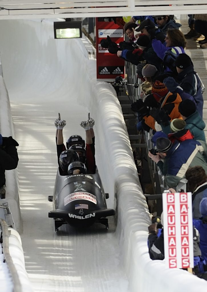 Steve Holcomb bobsledding with arms up