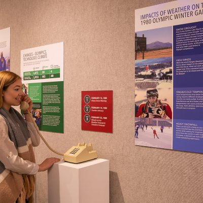 Girl enjoying exhibit at Lake Placid Olympic Museum